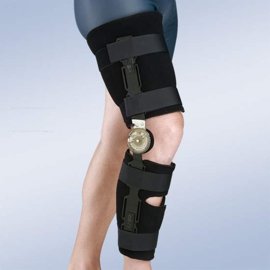 Ortesis de rodilla con bloqueo - Ortesis de rodilla monocéntrica que consta de dos cinchas de foam y velour recortables, con bloqueo en extensión a 0º
