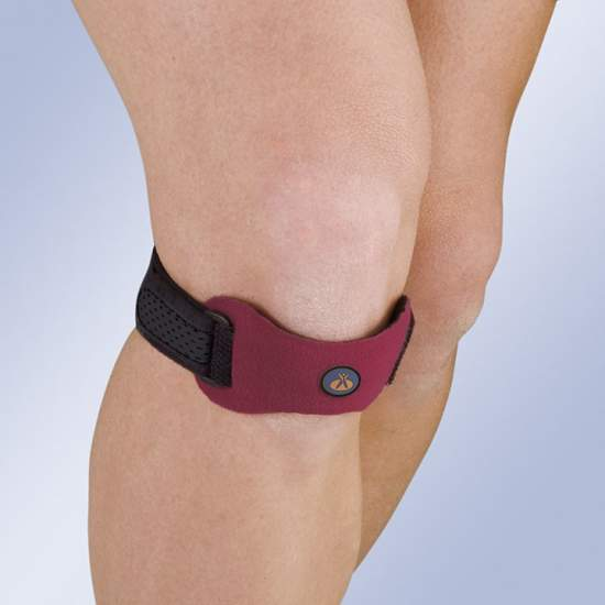 Apoio patelar com almofada de silicone - O suporte da patela é feito de veludo e de espuma e incorpora uma almofada de silicone.