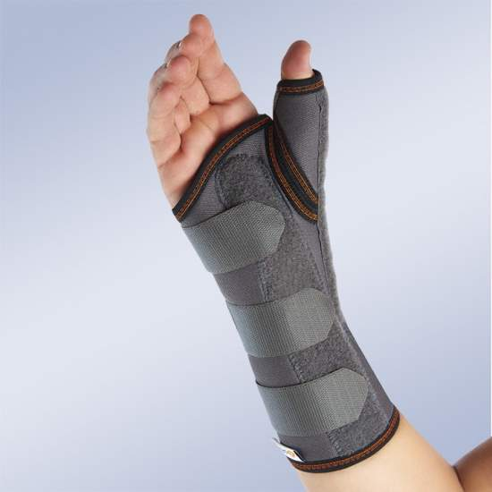 LONG WITH WRIST stun SEMIRRIGIDA THUMB SPLINT ORLIMAN - Wristband ready-made fabric padded, breathable rigid internal loop and cotton abductor splint thumb moldable aluminum splint moldable and removable aluminum palmar hemispherical support, elastic Lycra in the back area that facilitates...
