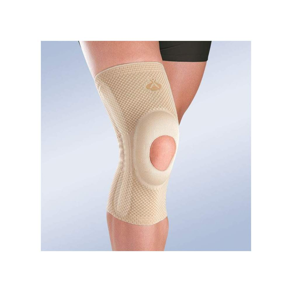 BREATHABLE ELASTIC KNEE WITH OPEN ROTULA SILICONE IMPELLER AND SIDE STABILIZERS 8105 - Breathable elastic knee brace with material made up to 140 filaments which provides active compression in 3 dimensions, with open kneecap and with distal and proximal ends...