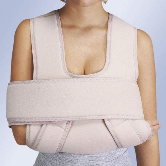ORLIMAN REINFORCED IMMOBILIZER CABESTRILLO -  Support made in velor-shaped bib for the forearm that wraps and closes on itself allowing height adjustment. It extends with two bands on each side of the shoulders, run down the back and close on the forearm with velcro. It has an...
