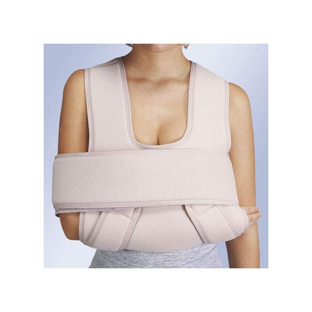 ORLIMAN REINFORCED IMMOBILIZER CABESTRILLO -  Support made in velor-shaped bib for the forearm that wraps and closes on itself allowing height adjustment. It extends with two bands on each side of the shoulders, run down...