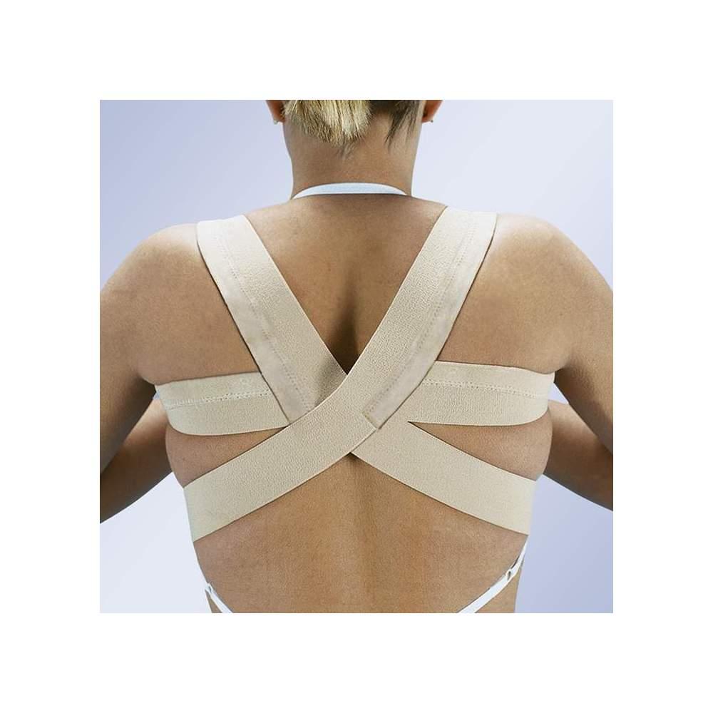 ESPALDERA EN OCHO E-240 - Consta de dos bandas de tejido elástico algodonado terminadas en anillo independientes para cada lado de los hombros. Los extremos de las bandas ejercen una tracción gradual...