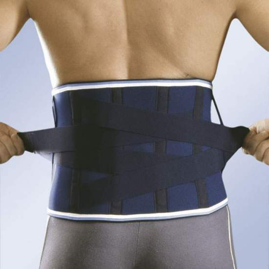 CROSS NEOPRENE STRIP WITH PILLOW 4203 -  Neoprene strip 4.5 mm. With steel whales, posterior cross bands with Velcro closure and moldable lumbar pad.