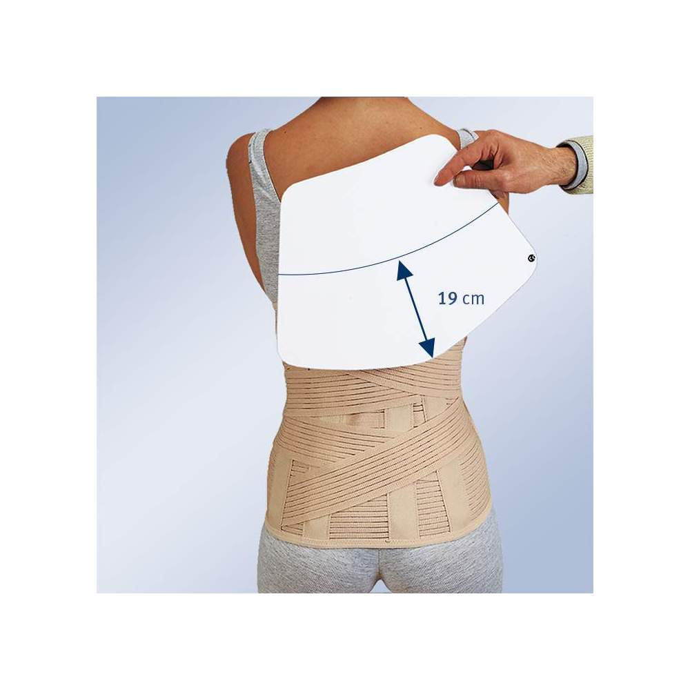 SHORT SACROLUMBAR BELT WITH BAG TO ACCOMMODATE THERMOMOLLABLE PLATE 1300 - Sacrolumbar girdle semi-rigid in breathable multiband material with two elastic straps crossed at the back that fasten on the front, vertical whales on the back and front velcro...