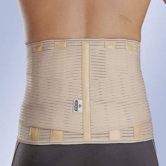 "BELT ""LUMBITRON STABLE FORTE"" SACROLUMBAR -  Elastic fabric, posterior semirigid whales, covered with leatherette, lateral reinforcements, velcro closure."