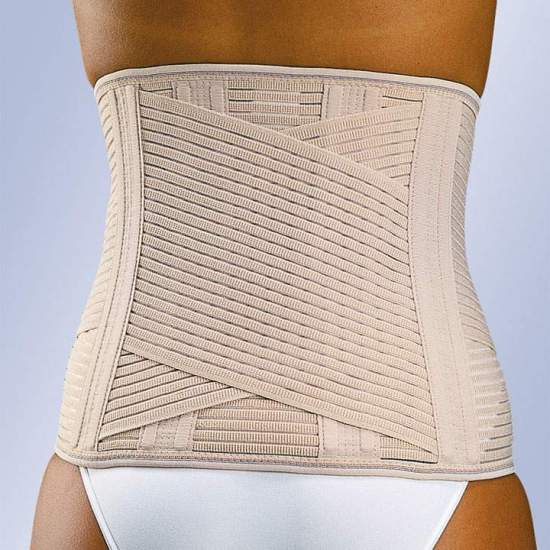 FAJA SACROLUMBAR LUMBITRON -  Lumbosacral strip in breathable multiband material with two crossed bands, vertical whales on the back and front velcro closure. The beige belt incorporates a foam lumbar plate to give heat in this area, which can be removed when not...