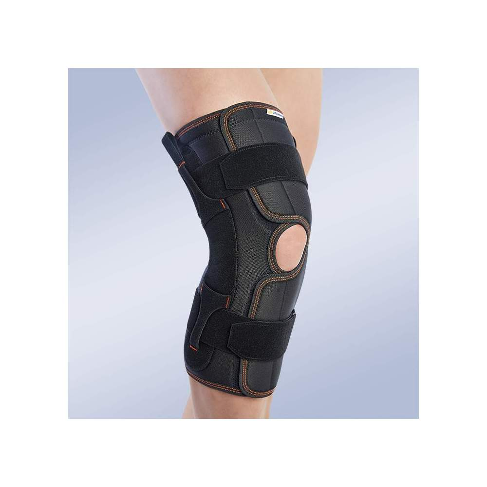 OPEN KNEE WITH POLYCENTRIC JOINTS -  Knee brace made of breathable elastic three-layer material. It consists of 3 layers that are divided into an elastic fabric based on microfibres, polyurethane foam and cotton...