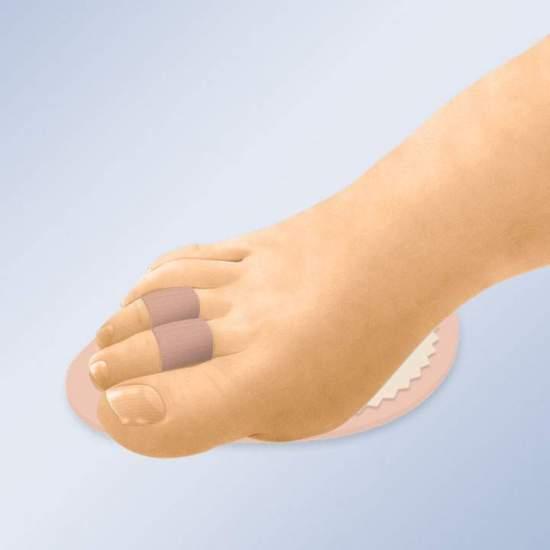 POIGNEE POUR LES DOIGTS EN HAMMER GL-205 -  Le coussinet est la solution idéale pour soulager la douleur provoquée par les doigts avec déviation axiale, fracturée ou martelée. L'alignement des doigts est obtenu par les anneaux ajustables, tandis que le coussinet doux à double...