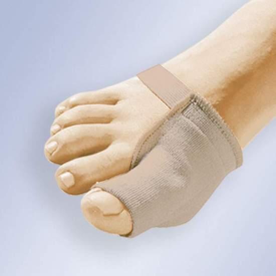Protector De Juanete En Gel Con Tejido Orliman Gl-103 - Protector que recoge la zona del juanete, insertándose en el dedo. Confeccionado en gel polímero viscoelástico recubierto de tela quirúrgica elástica y con cincha de sujeción al antepié.