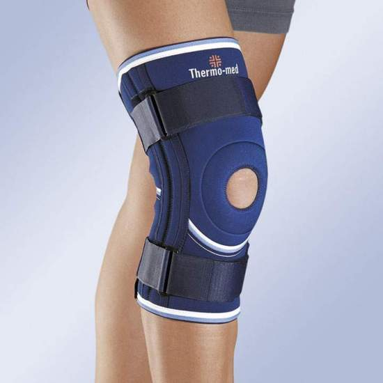 NEOPRENE KNEE WITH OPEN LABEL, LATERAL STABILIZERS AND FIXING RODS 4103 -  4.5 mm neoprene knee pad with flexible side stabilizers and upper and lower adjustment straps. Interchangeable patellar pad. Download popliteas.