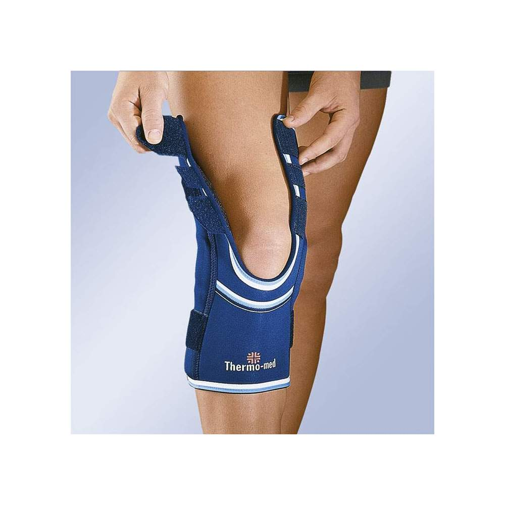 NEOPRENE KNEE WITH OPENINGS IN THIGH AND PANTORRILLA SIDE STABILIZERS AND ADJUSTMENT CINCHES 4103-A -  4.5 mm neoprene knee pad with flexible side stabilizers and upper and lower adjustment straps. Interchangeable patellar pad. Easy to put on and take off thanks to the openings...