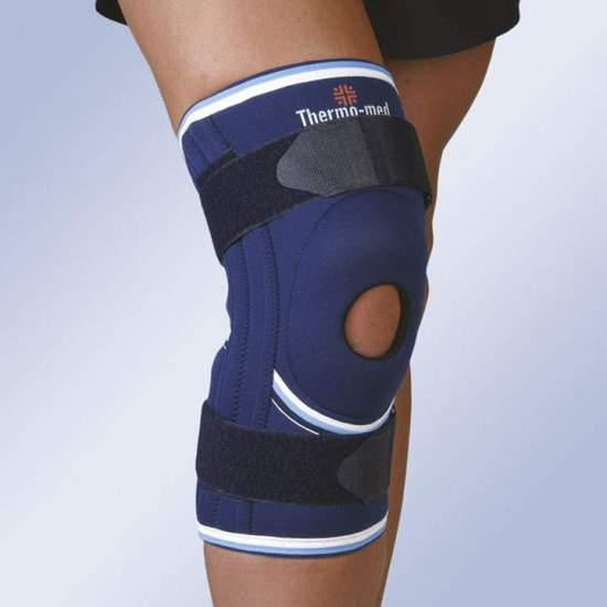 NEOPRENE STABILIZING KNEE WITH SILICONE ROTULINE ROLLER, SIDE STABILIZERS AND ADJUSTMENT CINCHES 4116 - 4.5 mm neoprene knee brace with open kneecap and spiral reinforcement whales for lateral stabilization. With silicone patellar impeller and straps with elastic portion for better fit. Back openings with Velcro on thigh and calf for...