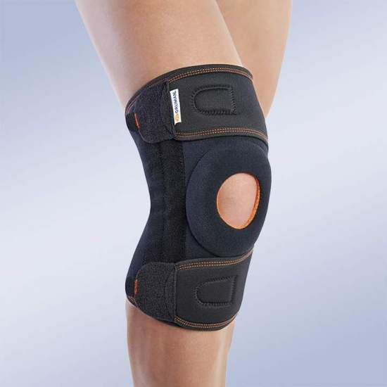 KNEE PAD WRAP WITH MID-SIDE STRAPS 7119 - Textile knee brace in breathable elastic three-layer material. Made of elastic velor (knee area) and elastic fabric (cinches area). Composed of 3 layers that are divided into an elastic fabric based on microfibres, polyurethane foam and...