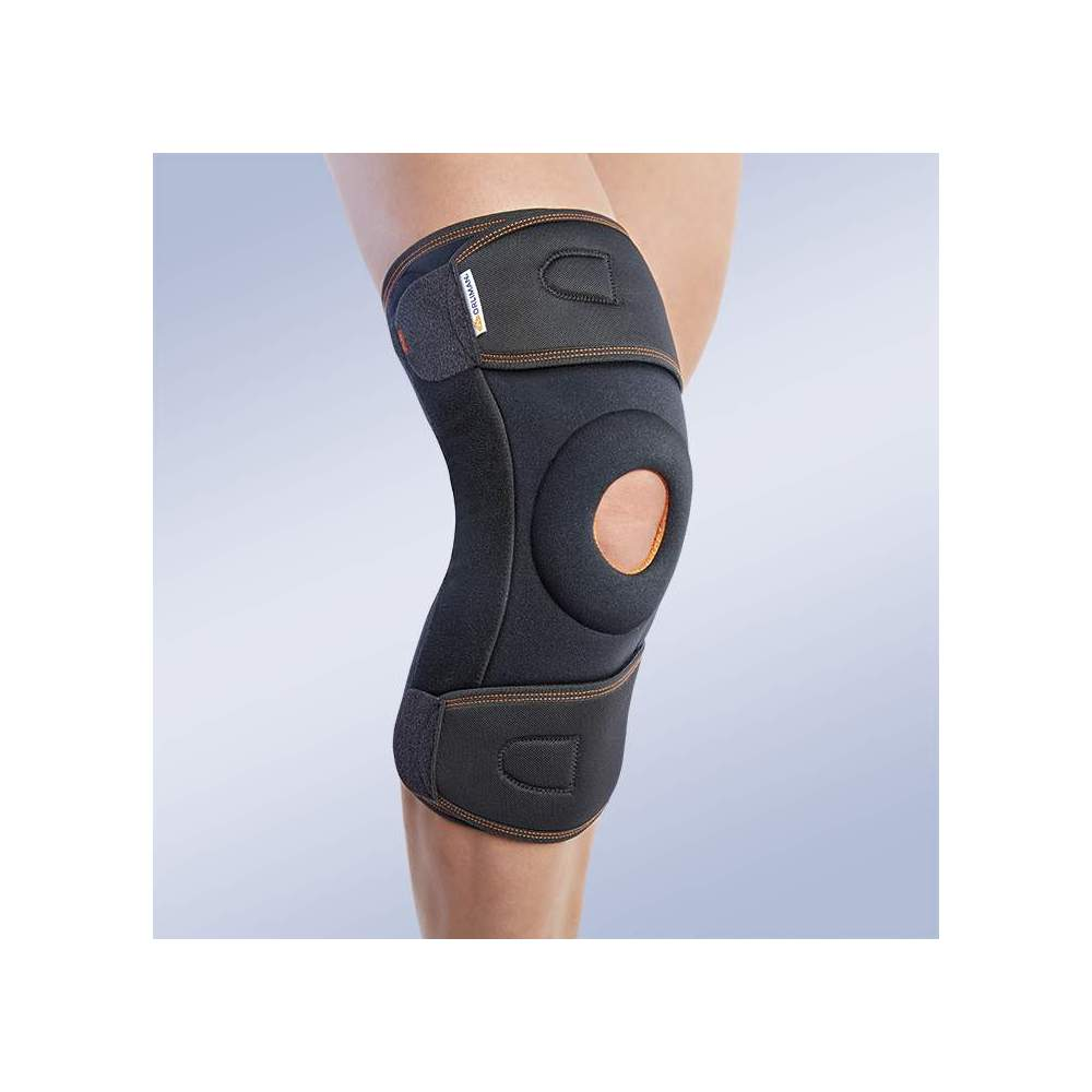 ENVELOPE KNEE PAD WITH POLYCENTRIC JOINTS - Textile knee brace in three-layer breathable elastic material. Made of elastic velor (knee area) and elastic fabric (cinches area); formed by 3 layers that are divided into an...