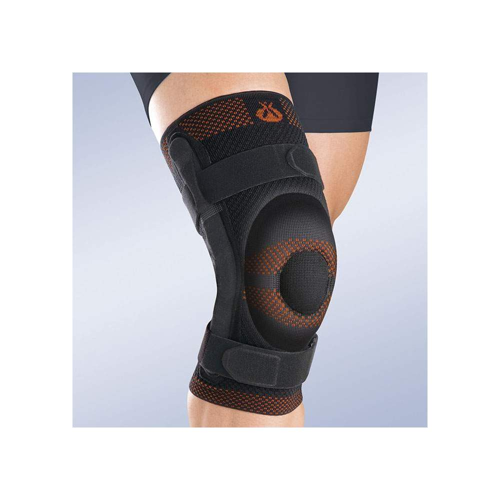 BREATHABLE ELASTIC KNEE PAD WITH CLOSED ROTULA SILICONE BEARING AND METALLIC STRAPS WITH POLYCENTRIC ARTICULATION - Made in three-dimensional knitted fabric, providing greater transverse elasticity while exerting the necessary compression in each area, this new concept of knitted fabric...