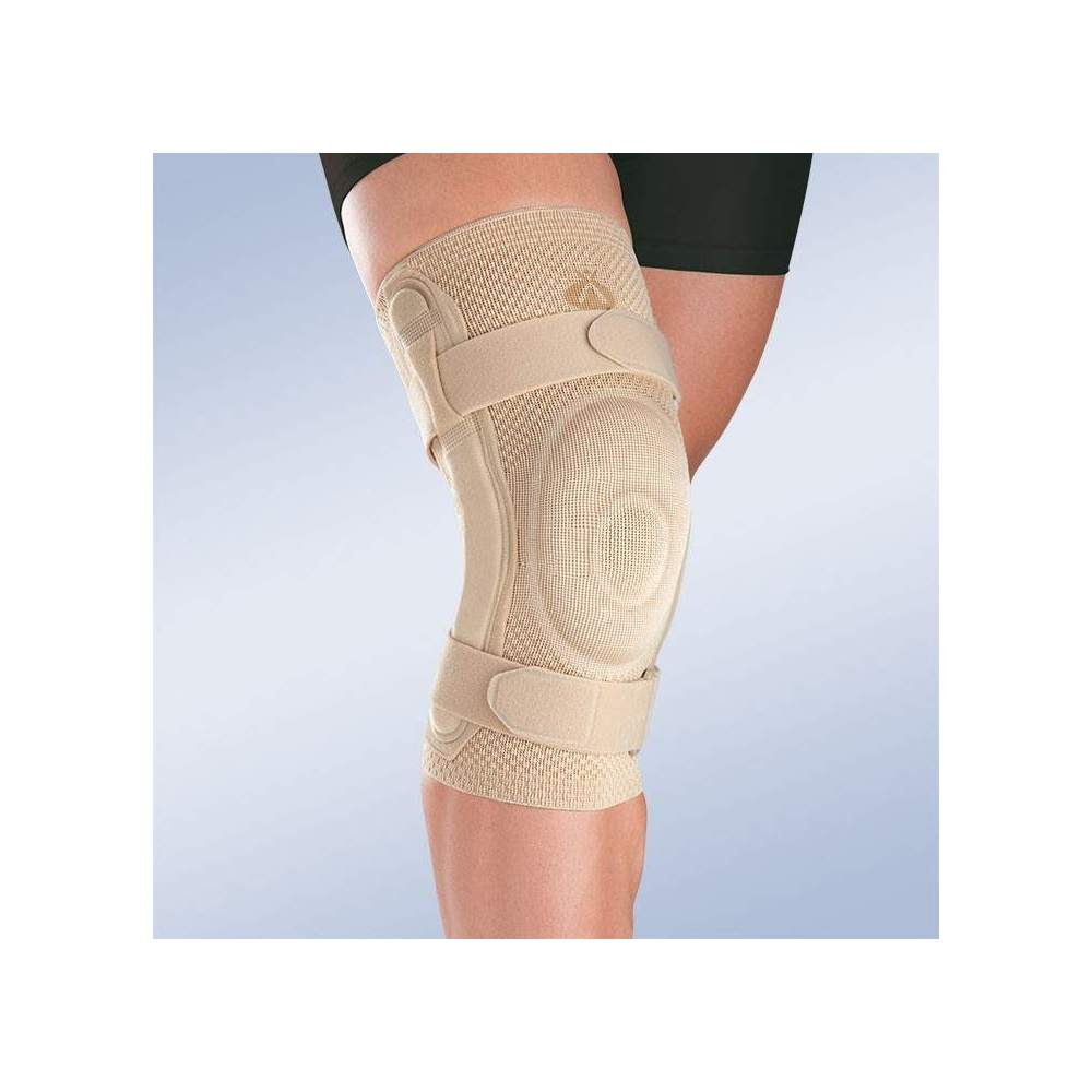 BREATHABLE ELASTIC KNEE PAD WITH CLOSED ROTULA SILICONE PEDAL AND METALLIC STRIPS WITH POLYCENTRIC ARTICULATION 9106 -  Made in three-dimensional knitted fabric, providing greater transverse elasticity while exerting the necessary compression in each area, this new concept of knitted fabric...