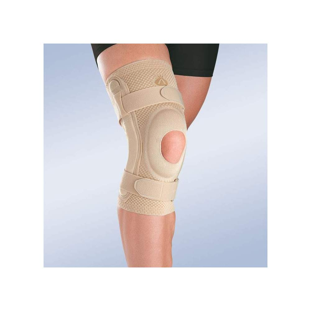BREATHABLE ELASTIC KNEE PAD WITH OPEN ROTULA SILICONE IMPRESSION AND METALLIC STRIPS WITH POLYCENTRIC ARTICULATION 9107 -  Made in three-dimensional knitted fabric, providing greater transverse elasticity while exerting the necessary compression in each area, this new concept of knitted fabric...