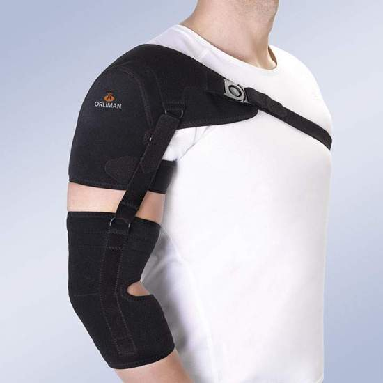 Shoulder support with arm and forearm strap - Orthosis made with breathable foam in velor for its outer face and inner lining of honeycomb fabric, closure systems by means of straps in micro-hook and buckles with button opening closure. The shoulder pad is reinforced by a 0.5mm...