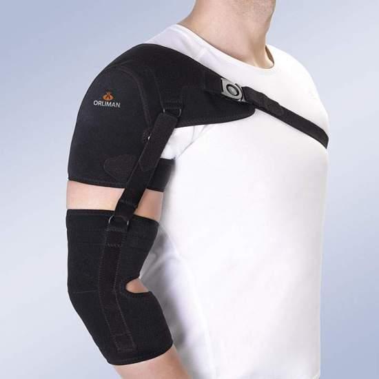 Support d'épaule avec bras et sangle d'avant-bras - Orthèse en mousse respirante en velours pour la face extérieure et la doublure intérieure en tissu alvéolaire, systèmes de fermeture au moyen de sangles en micro-crochet et de boucles à bouton. Le coussinet d'épaule est renforcé par un...