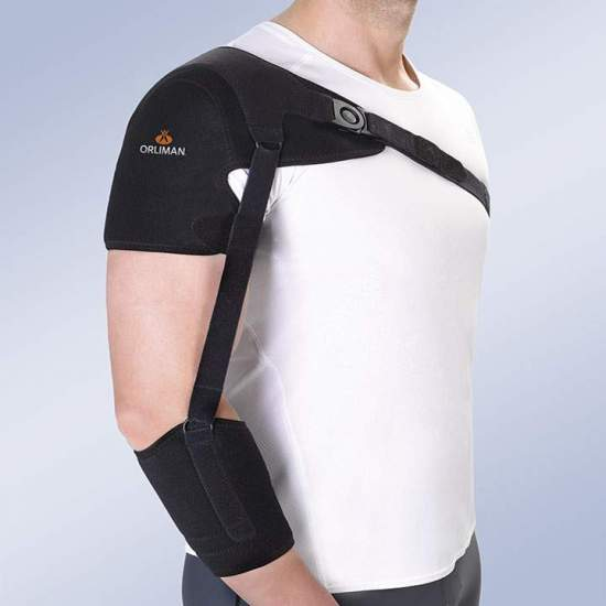 Shoulder support with forearm strap - Orthosis made with breathable foam in velor for its outer face and inner lining of honeycomb fabric, closure systems by means of straps in micro-hook and buckles with button opening closure. The shoulder pad is reinforced by a 0.5mm...